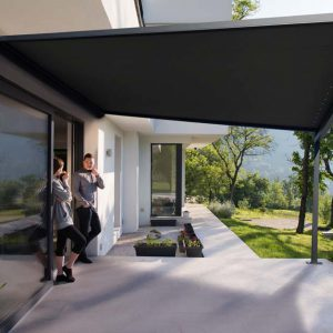 young beautiful handsome couple enjoying morning coffee on the door of their luxury home villa